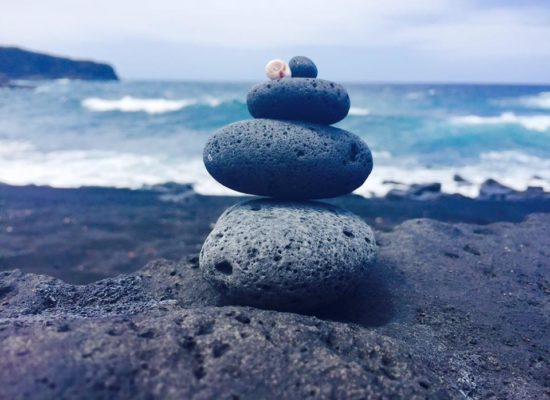 Pebbles stacked to represent correctly balancing your resources and getting them lined up in the right order and at the right time.