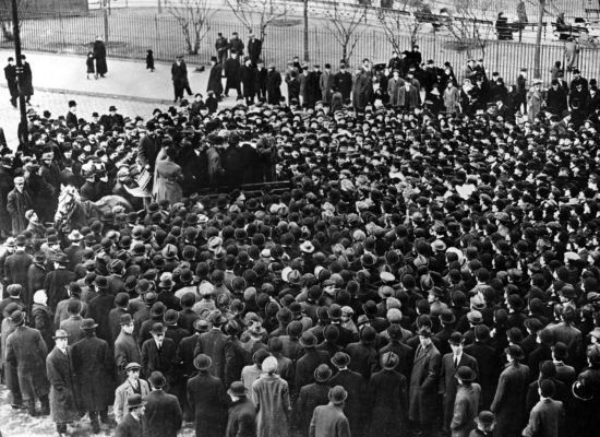 A black and white photo of a crowd symbolising a large solution development team.